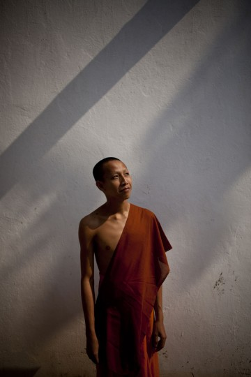 Portrait of a young monk in his monastery, Vientiane.