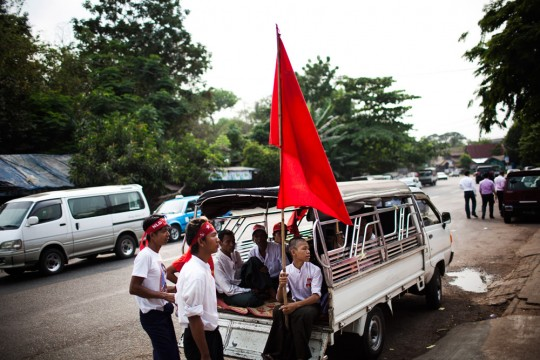 Young NLD supporters are seen in front of NLD&#039;s Yangon headquarters.