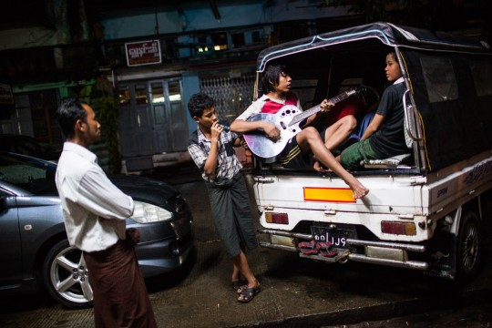 Youths are jamming on the streets in downtown Yangon.